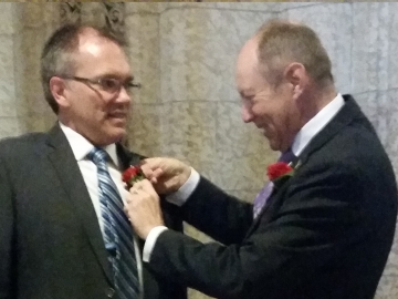 Kerry Diotte, MP pinning a carnation on Luc Berthold, MP