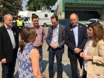 Speaking with Fort MacMurray fire victims at the Northlands relief centre