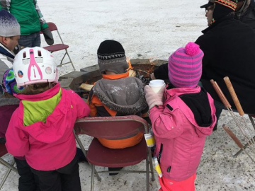 Warming by the fire at the Highland Community Family Day Event - Feb 19, 2018
