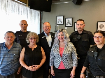 Attending Coffee With a Cop at The Carrot Cafe - July 4, 2018
