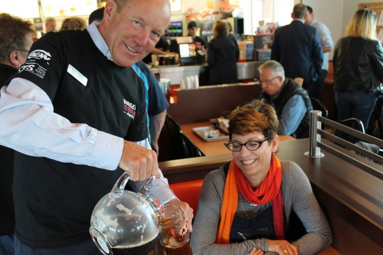 Kerry serving root beer at Burgers to Beat MS